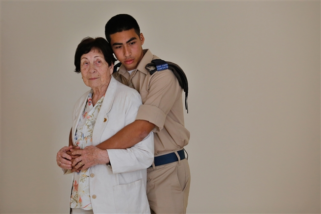 Israeli Holocaust survivor Fanny Ben Ami (L), 89, and her grandson soldier Eyal Ben Ami in Jerusalem on April, 2019.