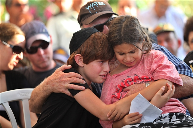 The children of Israeli soldier mourn during his funeral July 14